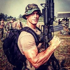 Navy SEAL Team 8 Operator and Close Quarters Combat and Urban Operations Instructor with Naval Special Warfare Group II Chris Mckinley Date and Location Unknown Sexy Military Men, Military Police, Usmc, Military Spouse, Gi Joe, Dynamic Stretching, Leg Stretching, Hot Cops, Men In Uniform