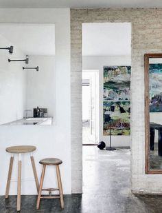 We recently featured an Updated Danish Farmhouse with enchantingly raw interiors: concrete floors, painted brick walls, and industrial lighting. Interior Windows, Interior Exterior, Danish Modern, Scandinavian Interior, Painted Brick Walls, Light Brick, Industrial Wall Lights, Style Minimaliste, Farmhouse Remodel