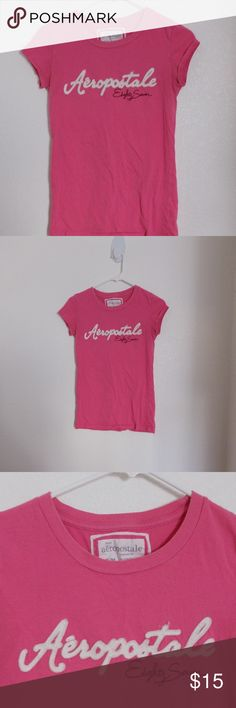 Aeropostale pink cap sleeve logo tee shirt Aeropostale pink cap sleeve crew neck tee shirt. WFL 8048 - CA53201. 100% cotton.   Size Medium - 36 waist, 24 length, 28 chest, 28 hip.  See photos for details. Smoke free, pet friendly home.   Please message me with any questions. Ask if additional size detail is needed.   15% discount for 3+ item bundles. Check out my closet. Happy Poshing!  39/O Aeropostale Tops Tees - Short Sleeve