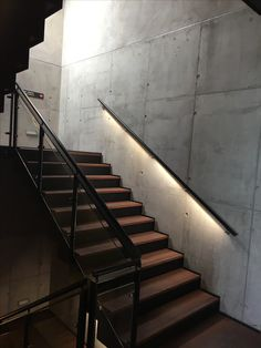 Black handrail with LED at Copenhagen AirPort. Design by Lightconstructor