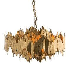 Hand-cut, hand-scorn, iron round circles, finished in gold leaf; are layered beautifully making this chandelier stunning at every angle.