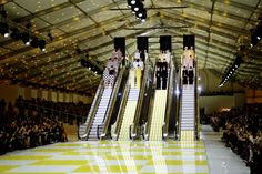 Photos From Paris That'll Leave You Breathless-Taking the escalator down at Louis Vuitton