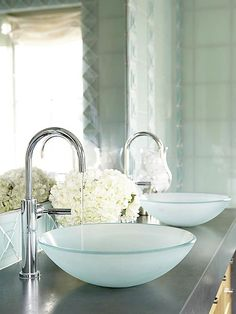 Adding sophistication and style to your bath can begin with the clean, simple elegance of these beautiful sink bowls, which rest on -- or are slightly set into -- the vanity countertop.