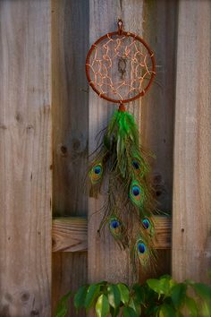 Large Copper Wire & Peacock Feather Dream by SistersOfMabon. $25.00, via Etsy.