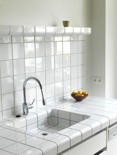 D-tile is a system which allows any space or object to be completely covered with tiles. This is possible because the D-tile collection consists of flat-, construction-, and function-tiles. The quality of all D-tile products, frost resistant stoneware, ensures that it is applicable everywhere and under all circumstances. And where white tiles are inappropriate, color tiles can be used. D-tile is for Belgium exclusively available at HELDER.