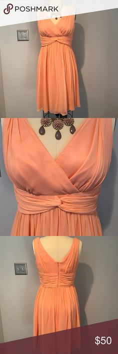 Donna Morgan chiffon bridesmaid/cocktail dress Beautiful coral/peach bridesmaid dress. Perfect also for any formal spring occasion. Chiffon over satin. V-neck with twist waist. Hits below knee. Worn once for a wedding. Zipper pull scratched from dry cleaning. Donna Morgan Dresses Midi