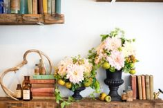 I love the books and the flowers and the gorgeous matte vases....