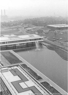 Create a smog and then build a high office to avoid the smog. Black and white photograph showing the exterior of the Head Office of Pilkington Brothers Limited , St. The Frank Sheen Collection St Helens Town, Saint Helens, Pilkington Glass, Family Album, Local History, My Town, The Past, Photograph, Exterior