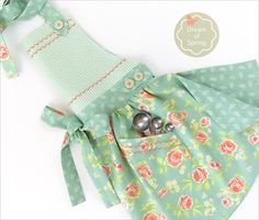 Soft Floral Apron with Curved Skirt and Button Accents | FREE detailed tutorial from Sew4Home
