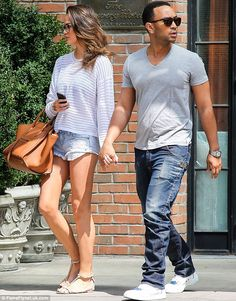 Chrissy Teigen, with fiancé, John Legend