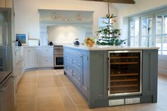Our Period English kitchen painted two shades of grey/blue. Our clients wanted a very large island with seating overlooking the garden and the wine cooler was a must! This kitchen has plenty of storage but remains very spacious.