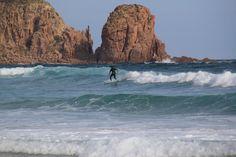 Surfing at Cape Woolamai, Phillip Island, Australia
