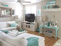 A totally beachy TV/Rec Room in white and aqua. Tour the entire cottage on BBL: http://beachblissliving.com/aqua-blue-beach-cottage-decor/