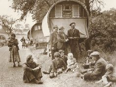 A gypsy family outside their caravan.