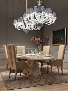 With Heritage Collection's Plisse table and high chairs dining is not only an event.  Beautiful and smooth pastel colors with the combination of the white chandeliers create the atmosphere you can dine with style. #luxury #living Salone del Mobile Milano 2015