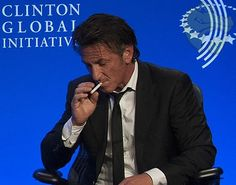 Sean Penn puts up a political smokescreen as he chugs on E-cigarette at Clinton Global Initiative conference
