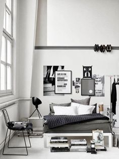 Elegant all-white bedroom with black furniture, accessories, and art…Classic!