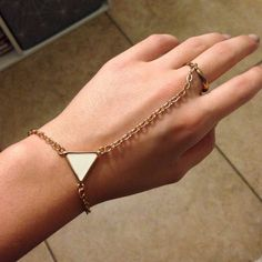 Bracelet/ring accessory Super cute bracelet attach ring. Has a white triangle on the middle, it can also size any hand. Wet Seal Jewelry