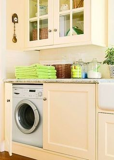 Hidden washer and dryer. Dream home idea... by christina carrera: love the sliding door concept, the cabinets above and the multi-use surface to top it all off.  What a great use of space! Add a crafting/supply storage table (eg.pottery barn) and you've got a great work space.