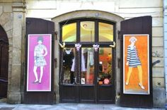 Vintage clothing store Prague. i like the big colourful banners on each side of entrance