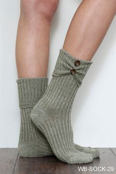These Crew Scrunch Button Boot Socks in Asst Colors are the perfect pairing with your favorite shortie boots.