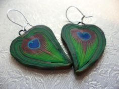 Hand crafted earrings. Polymer clay peacock design by Bratatouche on Etsy, £9.50
