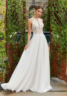 Shop the Blu by Mori Lee Polina 5703 Wedding Dress! This A-line chiffon gown features a sleeveless lace bodice with crystals, pearls, and an illusion back. Mori Lee Wedding Gowns, Mori Lee Bridal, Western Wedding Dresses, Lace Wedding Dress, Long Sleeve Wedding, Princess Wedding Dresses, Wedding Dress Shopping, Modest Wedding Dresses, Perfect Wedding Dress
