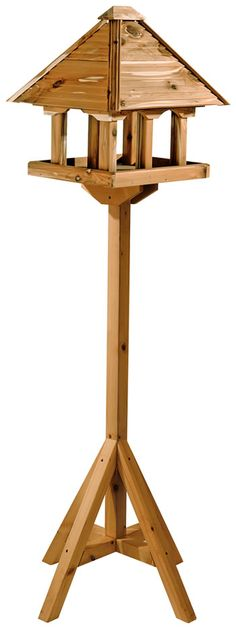 Self assembly bird table is made from aromatic red cedar and has 6 columns to deter bigger birds from feeding here.