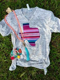 A personal favorite from my Etsy shop https://www.etsy.com/listing/387375952/fuschia-serape-turquoise-texas-shirt