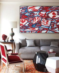 In a New York City home designed by Robert Couturier, a Jean Dubuffet painting is displayed above the living room sofa.