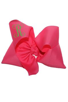 "This personalized large fuchsia hair bow is made of 3"" grosgrain ribbon to give you the fullest effect. It is a popular gift among young tweens and teens and even high school kids! Turnaround time is 3 business days plus shipping time. For customization please email Stylist@shoptiques.com with your choice of heat press color, monogram style and monogram initials. All custom items are final sale.     Measures: 7"" - 8"" across   Personalized Fuchsia Bow by Party Cat. Accessories Austin, Texas"