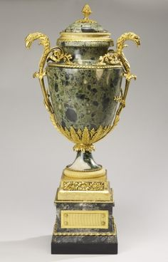 "*Late-18th century French Urn (one of four) in the Royal Collection, UK - From the curators' comments: ""Set of four ornamental green, black and white marble urns and covers with gilt bronze mounts, the cover with a gilt bronze finial, with double eagle's head and acanthus scroll handles, and berried laurel leaf calyx; on a rectangular marble plinth with gilt bronze plaques."""