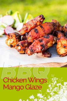 BBQ Chicken Wings are always a thing of great beauty, but the Mango Glaze on these bad boys push them right over the top and are the perfect kick-off to the BBQ Season! #chicken #chickenwings #hotwings #buffalowings #grilling #BBQ #recipe #recipeoftheday #recipeideas