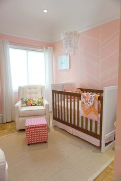 Modern Pink and White Nursery featuring a fab herringbone accent wall!
