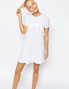 Buy it now. ASOS Swing Dress with Ruffle Detail - White. Dress by ASOS Collection, Lightweight fabric, Round neckline, Curved frill trim, Loose fit � falls loosely over the body, Machine wash, 95% Viscose, 5% Elastane, Our model wears a UK 8/EU 36/US 4 and is 175cm/5'9� tall. ABOUT ASOS COLLECTION Directional, exciting and diverse, the ASOS Collection makes and breaks the fashion rules. Scouring the globe for inspiration, our London based Design Team is inspired by fashion�s most coveta...