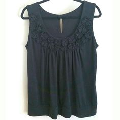 I just discovered this while shopping on Poshmark: SOLD.Black Sleeveless Top, Rosettes, Keyhole Back. Check it out! Price: $12 Size: 2X, listed by polishedtwo