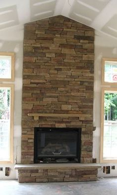 Stone Fireplace Design Ideas acacia wood fireplace shelf mantel with electric fireplace also stone fireplace design ideas and High Ceilings With Stone Fireplace