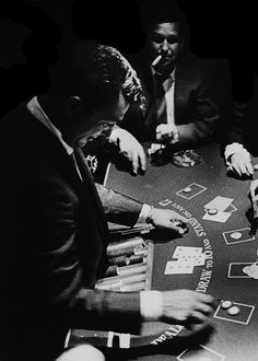 """deannmartin: """" Original caption: Dean Martin running his own game of blackjack at a casino in November of 1958. Photo by Allan Grant """""""