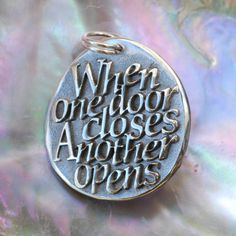When one door closes, another opens ... Inspirational Quote on Silver Pendant