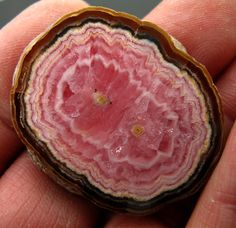 Perfect polished rhodochrosite round. Sold