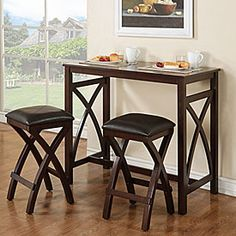 """This breakfast pub set makes a charming addition to any kitchen.  Perfect for apartments or small dining spaces Includes pub table and two faux-leather upholstered stools Made of wood and wood veneer Espresso finish Decorative X detailing on table base and stool legs Assembly required Table: 42""""W x 22""""D x 36""""H Stools (each): 14""""W x 14""""D x 25""""H"""