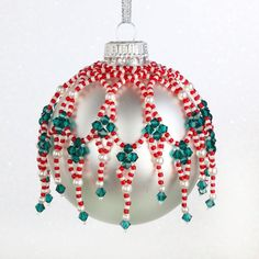 Source by jcpoirrier You could believe the real history of handcrafted beaded jewelry cannot possibl Felt Christmas Decorations, Beaded Christmas Ornaments, Ornament Crafts, Snowman Ornaments, Christmas Crafts, Christmas Tree, Beaded Ornament Covers, Baubles And Beads, Beaded Bracelet Patterns