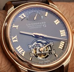 "Chopard L.U.C Tourbillon Qualite Fleurier Watch With Fairmined Gold Hands-On - by Vicky Van Halem - ""At Baselworld 2014, Chopard scored altruistic points with the release of a dashing Chopard L.U.C Tourbillon QF timepiece crafted from Fairmined Gold...The Chopard L.U.C Tourbillon is the first timepiece to use this type of gold, which is meant to be a more socially conscious gold in regard to how it was mined..."""