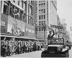 Gen. George Patton acknowledging the cheers of the welcoming crowds in Los Angeles, California, 9 Jun 1945 (US National Archives: ARC 535941)