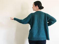A line seamed sweater knitting pattern with cable detail. Skidded by Kari-Helene Rane knit by orianalk in The Fibre Co. Arranmore Light - Kinnego Bay colour