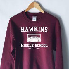 Hawkins Middle School AV Club Sweatshirt (32 CAD) ❤ liked on Polyvore featuring tops, hoodies, sweatshirts, purple top, purple sweatshirt and unisex tops