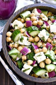 This Chickpea Cucumber Feta Salad has ALL the best flavors! Loaded with chickpeas, cucumbers, red onions, feta cheese, and fresh basil....this salad is so easy to make and is the perfect side dish for any meal! So. We're officially in week 3 of summer break. How is yours going?? So far....I have to say ours has been great! We finished our kitchen remodel (woot!), we unpacked the POD that's been sitting on our driveway (double woot!), and the girls each have2 full weeks of campunder ...