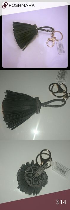 Extra wide tassel charm Charcoal grey extra wide tassel charm ... with gold studs around the top and the loop ... has a lobster clasp and a key ring ... perfect for putting on your keys, favorite purse, handbag, distressed jeans, ECT. ... the possibilities with this cutie are endless ... any questions please feel free to ask ... bundle this with another item and Save...So trendy : ) Accessories