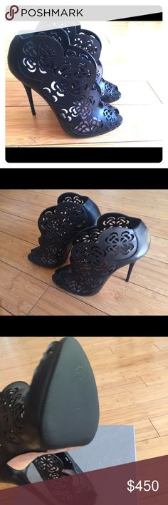"""Alexander Mcqueen booties! Size 38 Cut from black leather,Alexander McQueen's Flower Laser Cutout Bootie High Heels have a feminine scalloped edge and reveal the front slope of the foot to elegant effect. Only worn once - small scratches can be seen on the heel, but before use I went to a shoe repair and had rubber soles added for protection. Also shown on picture. Still have Box. True to size. • Heel measures 12cm / 4.7"""" • Leather (calf) • Slips on Alexander McQueen Shoes Ankle Boots…"""