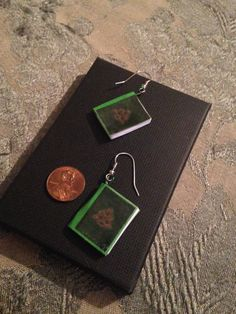 The Book of Shadows mini book earrings by GidgetsTreasures on Etsy #charmed #piper #prue #phoebe #paige #tv #minibookjewelry #bookearrings #bookcharms